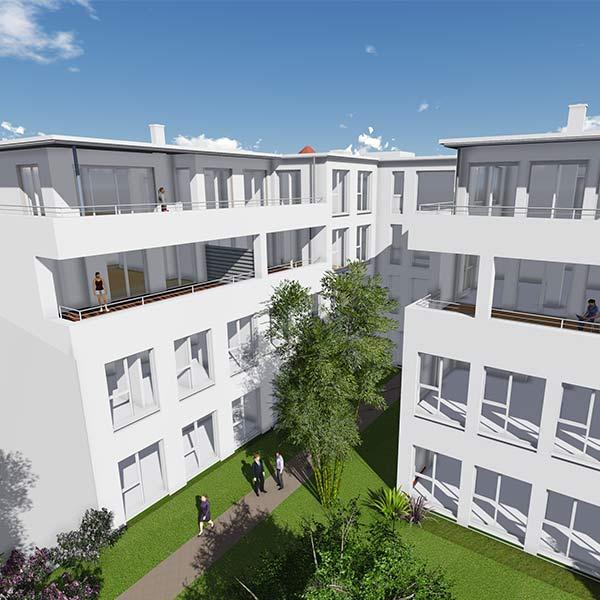 Der Neubau des Geschäfts- und Wohnhauses in Illtertissen wurde so geplant, dass es über einen ruhigen Innenhof verfügt.